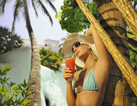 Beautiful woman drinking coctail outdoors photo