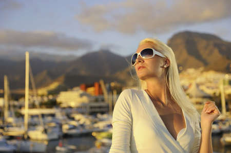 Attractive young woman near the yachts photo