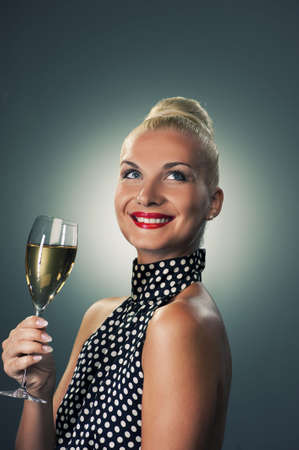 Beautiful woman with a glass of champagne photo
