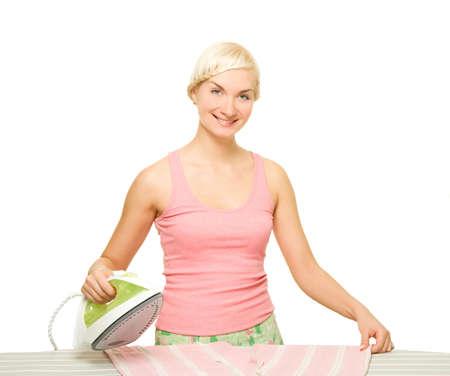 Beautiful woman ironing clothes. Isolated on white background      photo