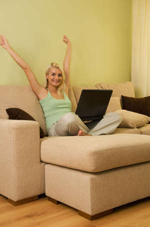Happy young woman at home photo