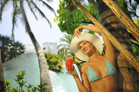 Beautiful woman drinking cocktail outdoors      photo
