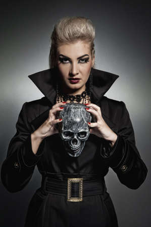 Witch with a scull  photo