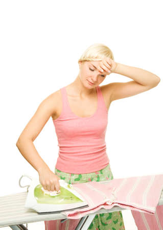Beautiful young woman ironing clothes photo
