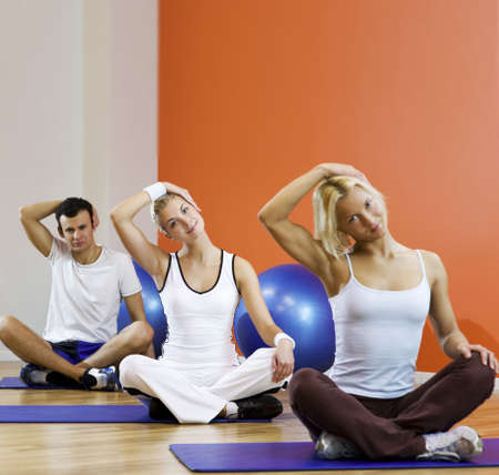 Group of people doing yoga exercise Stock Photo - 5510136