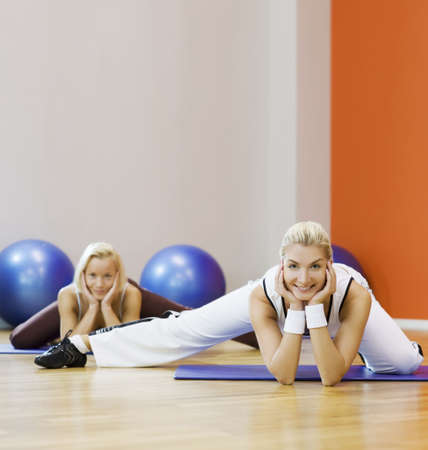 Group of people doing stretching exercise      photo