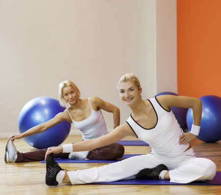 Group of people doing stretching exercise Stock Photo - 5510126