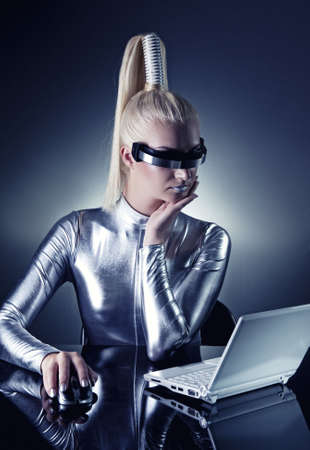 Beautiful cyber woman working on her laptop Stock Photo - 5509995