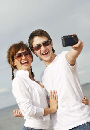 Happy couple taking a selfshoot picture photo