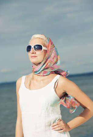 Beautiful young woman outdoors photo