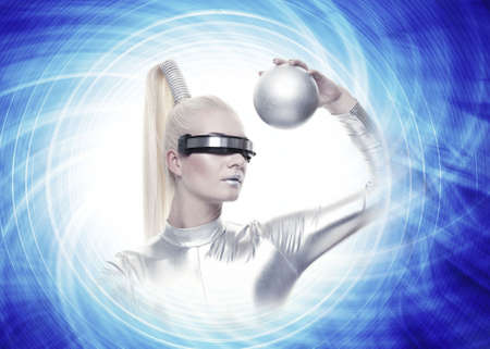 Beautiful cyber woman with a silver ball photo
