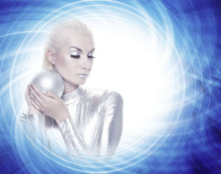 Beautiful woman with a silver ball photo