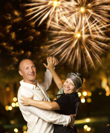 new year dance: Middle-aged couple dancing waltz at night
