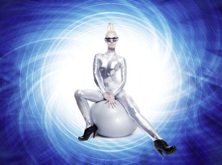 Beautiful cyber woman sitting on a silver ball   Stock Photo - 5591179