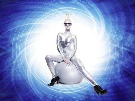 Beautiful cyber woman sitting on a silver ball Stock Photo - 5591179