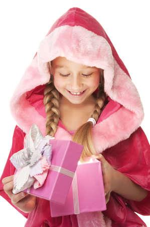 Little Christmas girl open her present photo