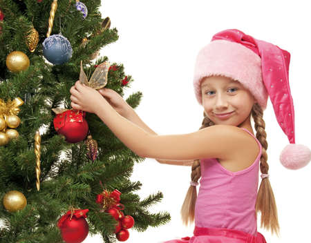 Little santa girl decorating the christmas tree Stock Photo - 5609526