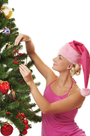 Santa girl decorating the christmas tree photo