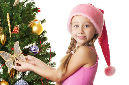 Little santa girl decorating the christmas tree Stock Photo - 5609525