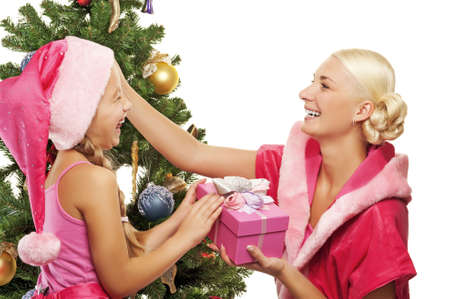 Mother and daughter celebrating christmas photo