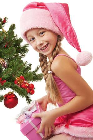 Little santa girl holding a gift box      photo