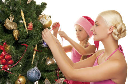 Mother and daughter decorating the christmas tree      photo