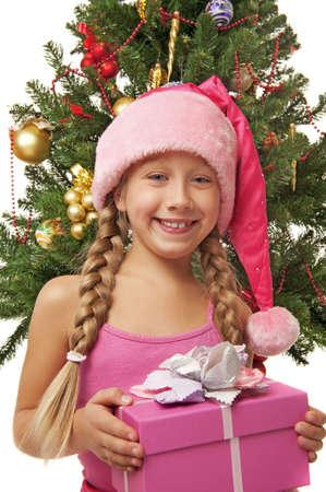 Happy Santa girl near the christmas tree      photo