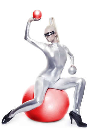 futuristic girl: Beautiful cyber woman sitting on a red ball