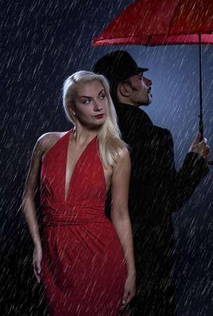 Couple in love standing under umbrella photo