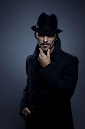 Mysterious man retro portrait photo