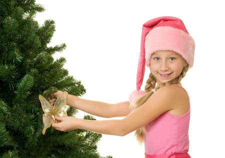 Little santa girl decorating the christmas tree Stock Photo - 5670645