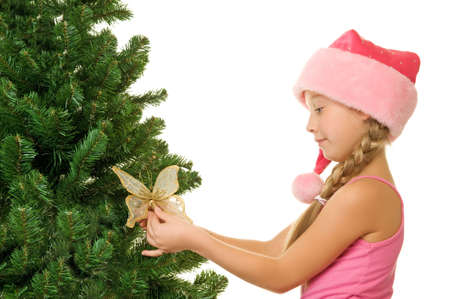 Little santa girl decorating the christmas tree Stock Photo - 5670647