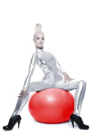Beautiful cyber woman sitting on a red ball   Stock Photo - 5670662