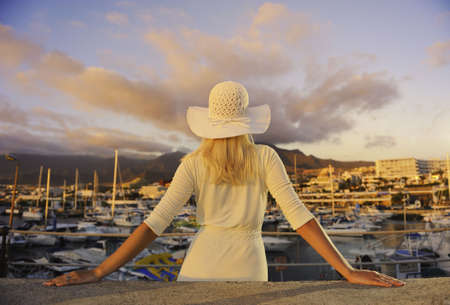 wealthy lifestyle: Attractive young woman near the yachts