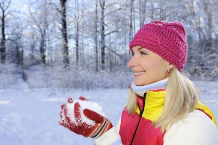 Frozen beautiful woman in winter clothing outdoors      photo