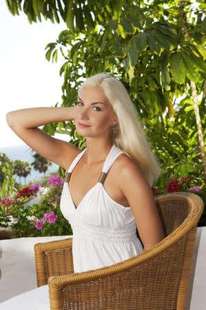 Beautiful woman relaxing outdoors      photo