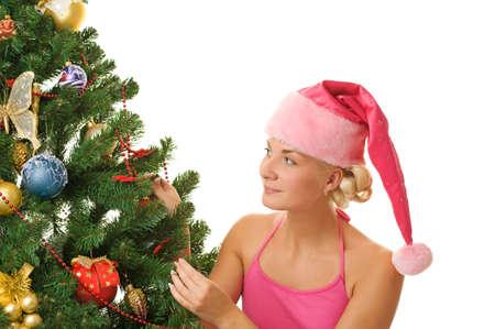 Santa girl decorating christmas tree photo