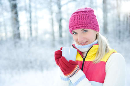 Beautiful blond woman drinking hot tea outdoors   Stock Photo - 5714647