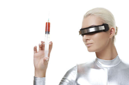 Beautiful cyber woman with syringe  photo