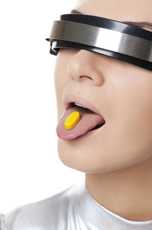 Beautiful cyber woman with a pill photo