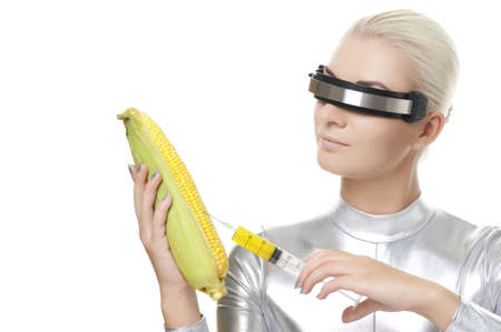 Cyber woman taking a vitamins from corn photo