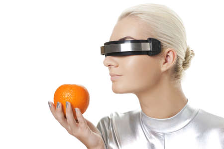 Cyber woman with an orange Stock Photo - 5714624