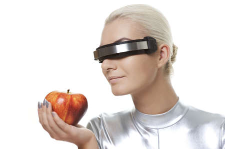 Cyber woman with an apple Stock Photo - 5714628