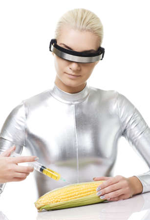 Cyber woman taking a vitamins from corn Stock Photo - 5750768