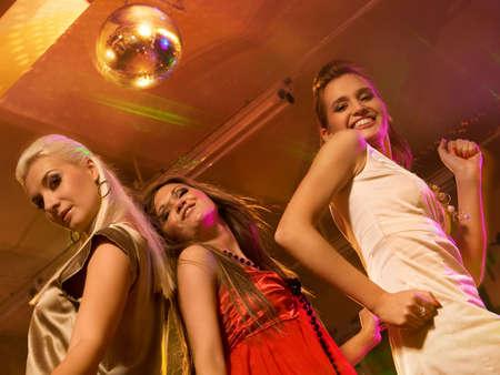 Girls dancing in the night club photo