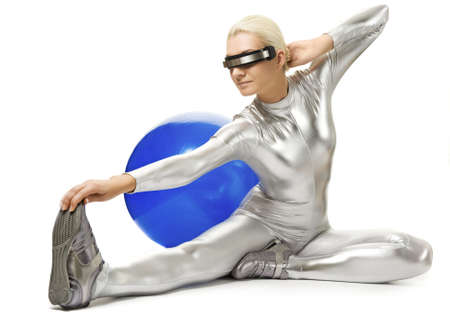 Beautiful cyber woman doing stretching exercise photo