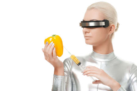 Cyber woman taking vitamins from sweet pepper Stock Photo - 5789023
