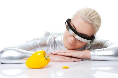 Cyber woman choosing between sweet pepper and pills Stock Photo - 5788566