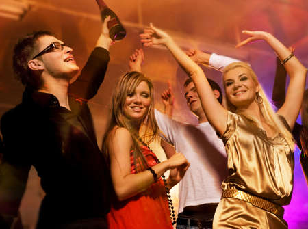 woman night: People dancing in the night club Stock Photo