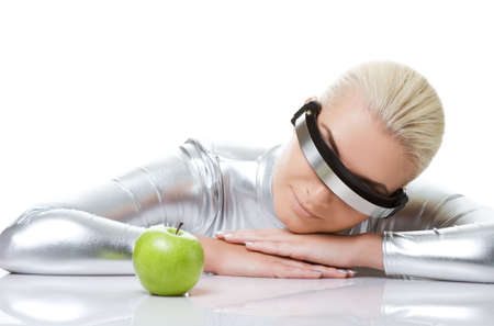 Cyber woman with a green apple Stock Photo - 5789156